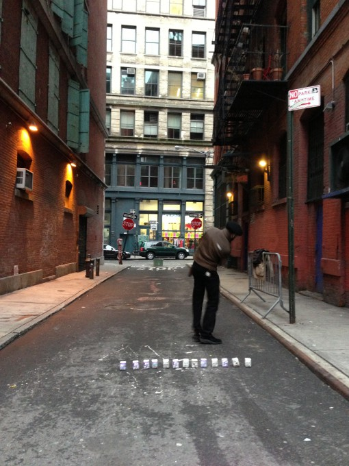 Someone is playing golf with cube paper ball in Soho